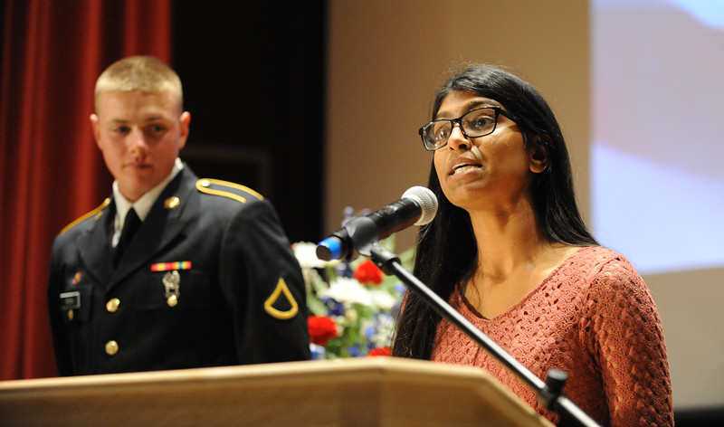 Daniel Rosa, Army Reserves, looks on as Trisha Pakkala, Phillipsburg High School senior, offers introductory remarks. Phillipsburg area veterans Sunday, Nov. 11, 2018  were honored during the 21st annual William L. Nixon tribute. Hundreds attended the event at Phillipsburg High School in Lopatcong Township, in which the U.S. Department of Veterans Affairs has honored as a regional site for the observance of the commemoration.