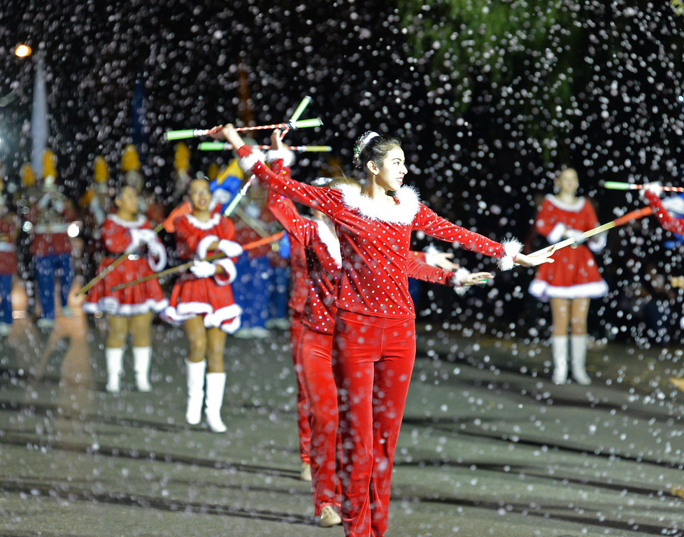 . The 60th annual Daisy Avenue Parade in the Wrigley neighborhood Saturday, December 13, 2013, in Long Beach, CA.  The Long Beach Junior Concert Band sprays fake snow along the parade route. Photo by Steve McCrank/DailyBreeze