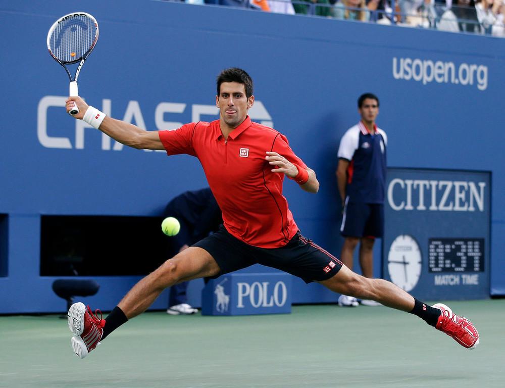 . Novak Djokovic, of Serbia, returns a shot to Rafael Nadal, of Spain, during the men\'s singles final of the 2013 U.S. Open tennis tournament, Monday, Sept. 9, 2013, in New York. (AP Photo/Darron Cummings)