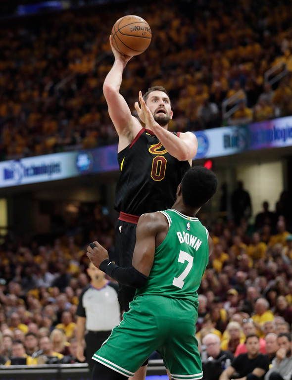 . Cleveland Cavaliers\' Kevin Love (0) shoots over Boston Celtics\' Jaylen Brown (7) in the first half of Game 3 of the NBA basketball Eastern Conference finals, Saturday, May 19, 2018, in Cleveland. (AP Photo/Tony Dejak)