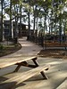 timber table and benches and concrete path with steel fencing