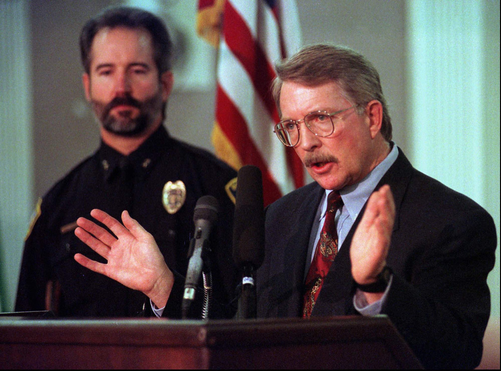. District Attorney Alex Hunter, right, answers questions, Feb. 13, 1997, about the murder of 6-year-old JonBenet Ramsey during a news conference with Boulder Police chief Tom Koby in Boulder, Colo. Nearly a year after the Dec. 26, 1996, crime, no suspects have been named.(AP Photo/Joe Mahoney, FILE)