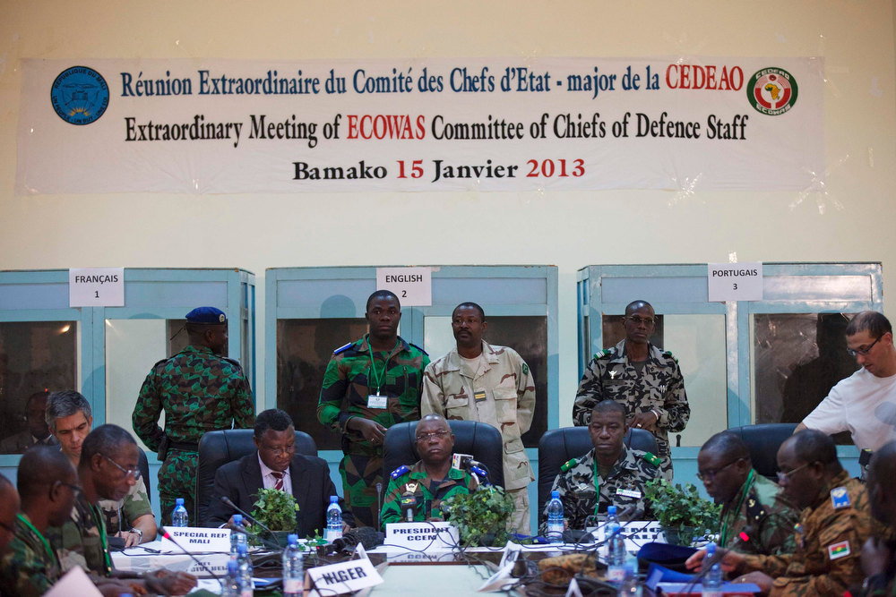Description of . West African army chiefs from regional bloc ECOWAS attend a meeting in Bamako January 15, 2013. France kept up its air strikes against Islamist rebels in Mali as plans to deploy African troops gathered pace on Tuesday amid concerns that delays could endanger a wider mission to dislodge al Qaeda and its allies.    REUTERS/Joe Penney