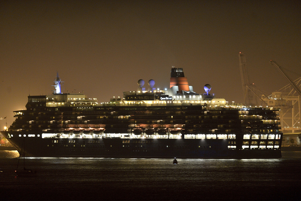 . LONG BEACH, CALIF. USA -- The youngest Cunard Line ship, Queen Elizabeth, heads out of Long Beach (Calif.) Harbor after visiting the Queen Mary on March 12, 2013. The Queen Mary was built by Cunard in 1936 and retired in 1967. The Queen Mary, now a permanently berthed, is a hotel and special events venue. The two ships exchanged whistle blows.   Photo by Jeff Gritchen / Los Angeles Newspaper Group
