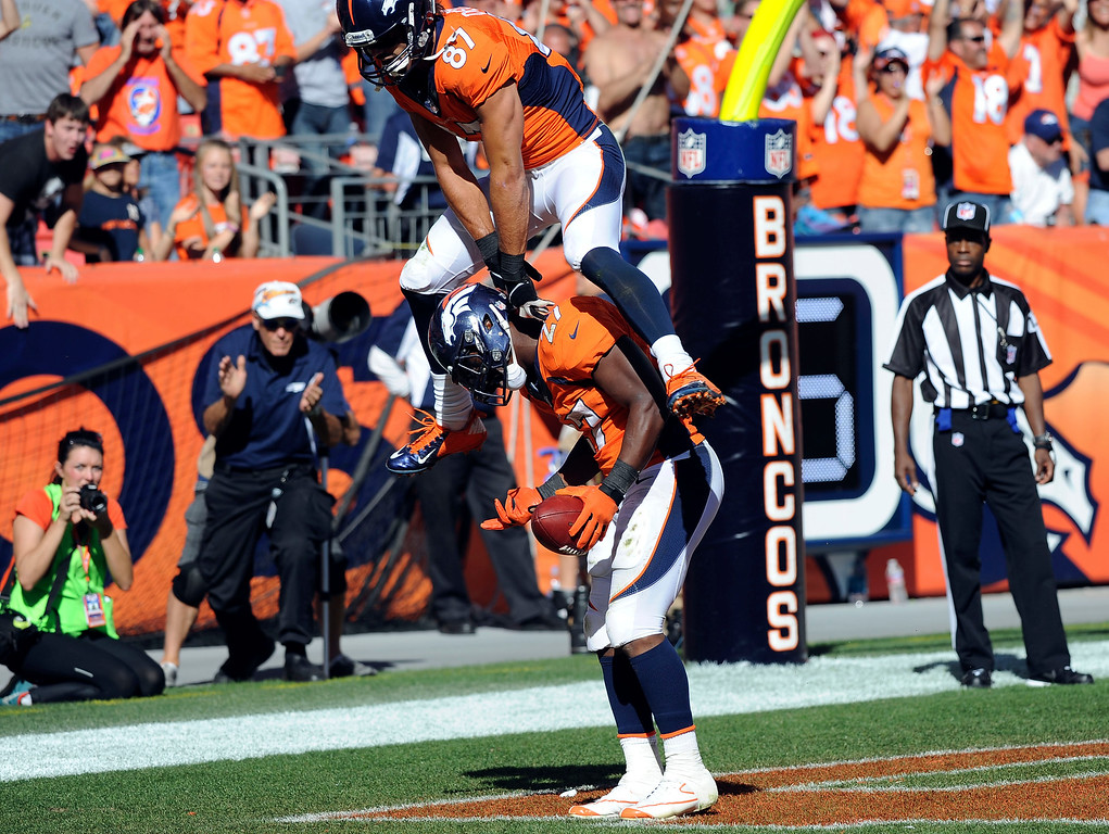 . Denver Broncos  wide receiver Erid Decker leap frogs Knowshon Moreno after a touchdown in the second quarter.  (Photo by Steve Nehf/The Denver Post)