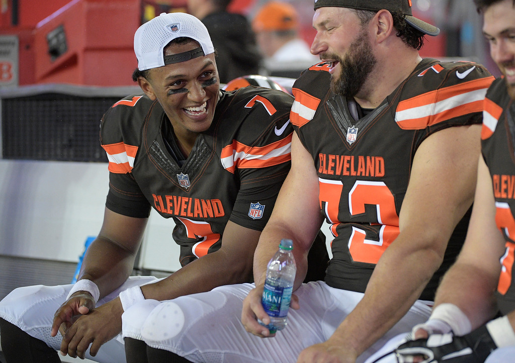 . Cleveland Browns quarterback DeShone Kizer (7) laughs with tackle Joe Thomas during the third quarter of an NFL preseason football game against the Tampa Bay Buccaneers Saturday, Aug. 26, 2017, in Tampa, Fla. (AP Photo/Phelan Ebenhack)