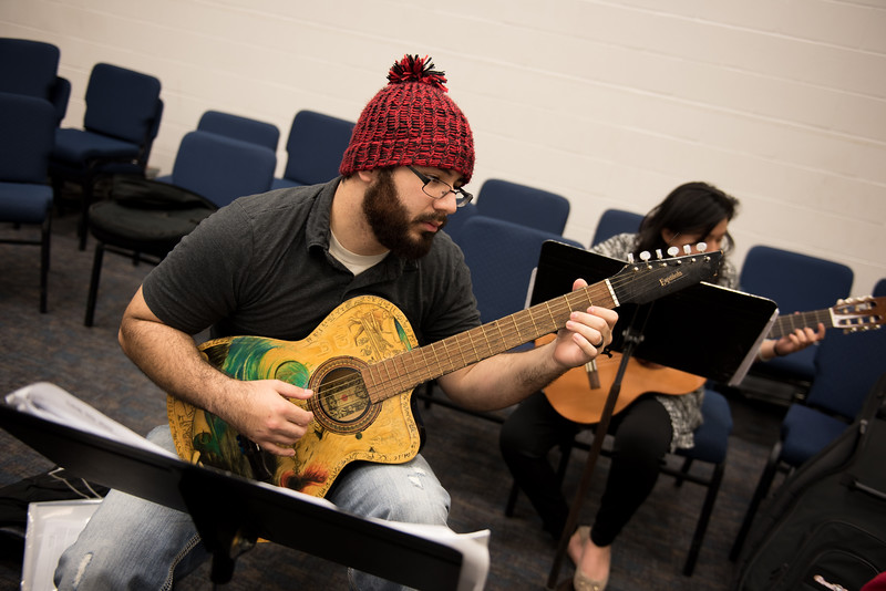 Student Daniel Ramierz practices on his guitar in the Center for Arts building.