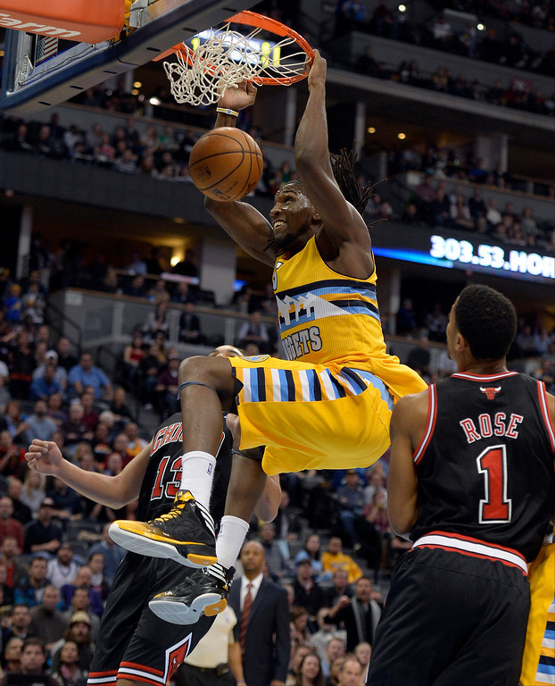 . Denver Nuggets power forward Kenneth Faried (35) gets a monster dunk as Chicago Bulls point guard Derrick Rose (1) looks on during the first quarter November 21, 2013 at Pepsi Center. (Photo by John Leyba/The Denver Post)