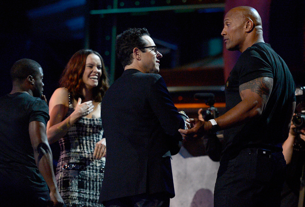 . Kevin Hart, from left, Daisy Ridley, J.J. Abrams and Dwayne Johnson are seen at the conclusion of the MTV Movie Awards at Warner Bros. Studio on Saturday, April 9, 2016, in Burbank, Calif. (Kevork Djansezian/Pool Photo via AP)