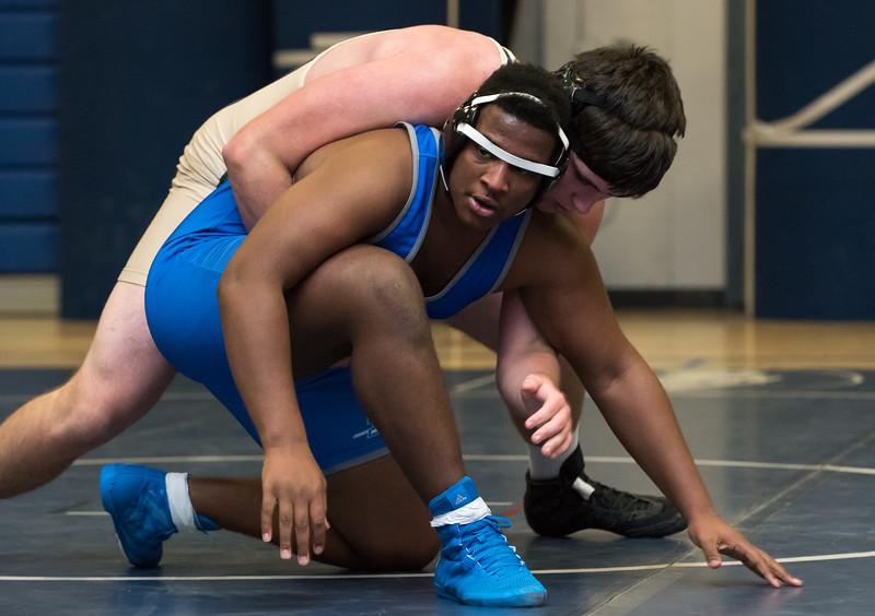 12/13/17  Wesley Bunnell | Staff  Plainville wrestling defeated Newington Wednesday evening at Plainville High School.  Newington's Wyatt Bernard vs Plainville's Travis Boone in the 220lb match.