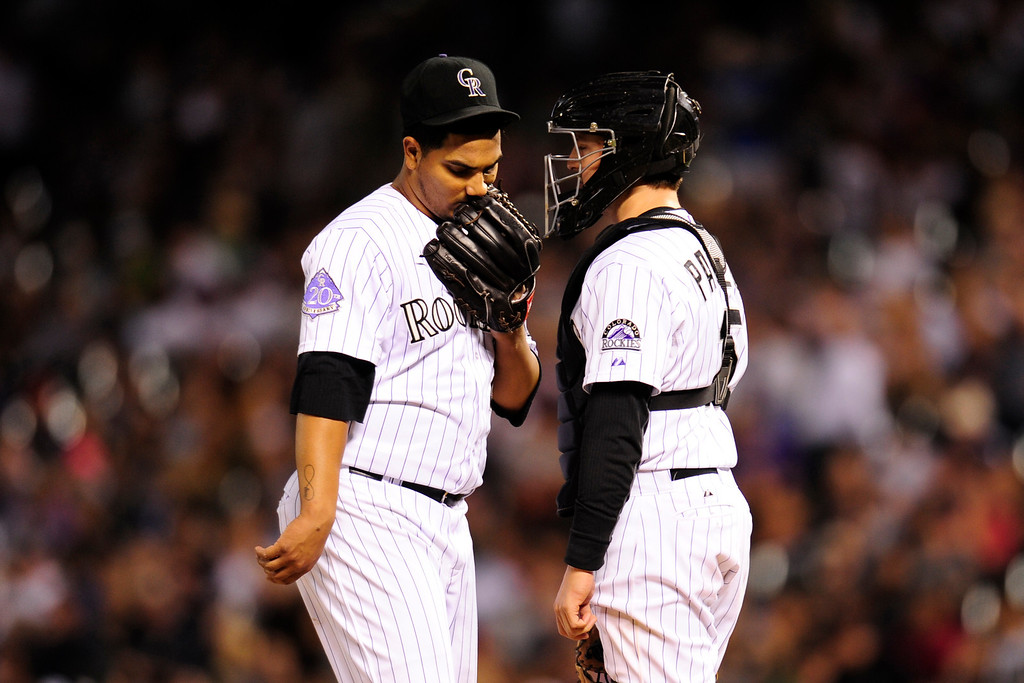 . DENVER, CO. - SEPT 20, 2013:   Pitcher Jhoulys Chacin discusses the game on the mound during the sixth inning.   (Photo By Erin Hull/The Denver Post)