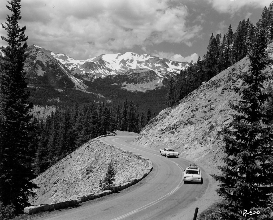 . Broad, smooth highways take vacationist high into the Colorado Rockies where miles stand on end. Wide turnouts and parking areas are located at spectacular scenic spots like this section of Trail Ridge Road in Rocky Mountain National Park. Near here, the road reaches an elevation of 12,133 feet, more than two miles above sea level. (Denver Post Library photo archive)