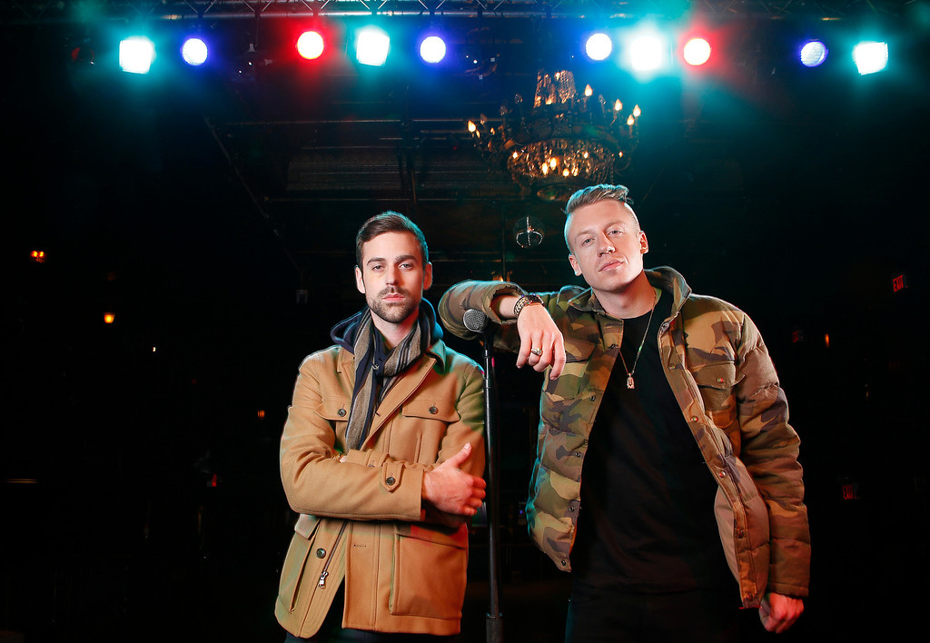 . FILE - In this Nov. 20, 2012 file photo, American musician Ben Haggerty, better known by his stage name Macklemore, right, and his producer Ryan Lewis pose for a portrait at Irving Plaza in New York.  Macklemore & Ryan Lewis are top contenders at the Grammy Awards on Sunday, Jan. 26, 2014, with seven nominations, including best new artist and song of the year for ìSame Love.î Their debut album, ìThe Heist,î is up for album of the year and best rap album, while the massive hit ìThrift Shopî is nominated for best rap song and rap performance. The duoís other hit, ìCanít Hold Us,î will compete for best music video. (Photo by Carlo Allegri/Invision/AP, File)