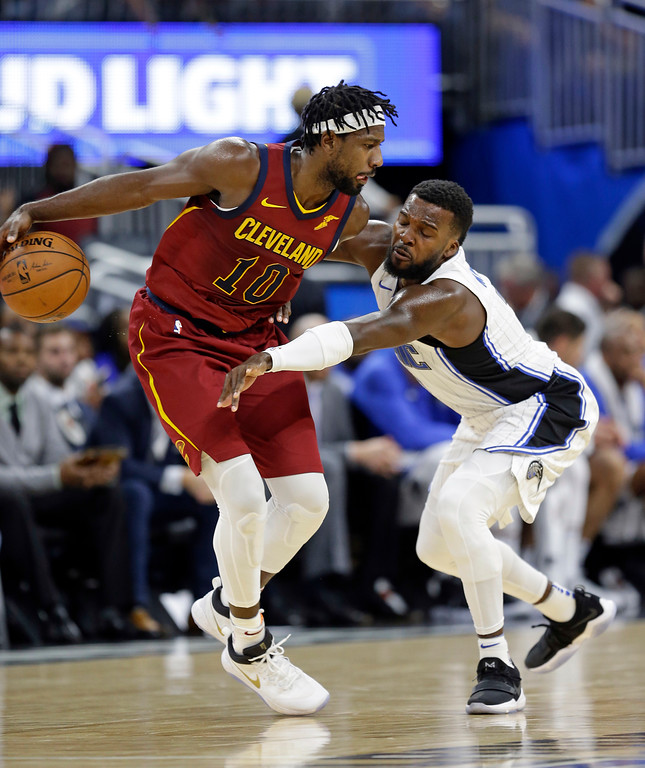 . Orlando Magic\'s Shelvin Mack, right, reaches in to try to steal the ball from Cleveland Cavaliers\' John Holland (10) during the second half of an NBA preseason basketball game, Friday, Oct. 13, 2017, in Orlando, Fla. Cleveland won 113-106. (AP Photo/John Raoux)