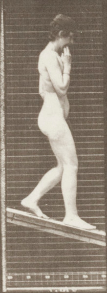 Nude woman descending an incline with one hand on chin