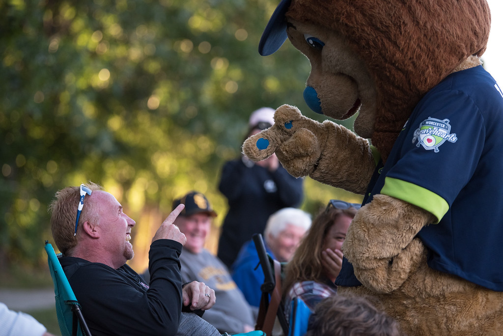 . A Dirt Dawgs fan taunts the Bravehearts mascot as he ventures over to the opposing side during game 1 of the Futures League playoffs where the Wachusett Dirt Dawgs face off against the Worcester Bravehearts on Tuesday Aug. 8, 2017 at Doyle Field in Leominster.  SENTINEL & ENTERPRISE/ JEFF PORTER