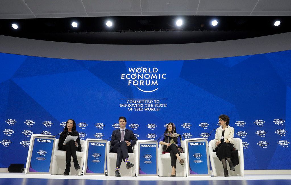 . Nobel laureate Malala Yousafzai, second right, and Canada\'s Prime Minister Justin Trudeau are flanked by Fabiola Gianotti, right, and Orit Gadiesh during the annual meeting of the World Economic Forum in Davos, Switzerland, Thursday, Jan. 25, 2018. (AP Photo/Markus Schreiber)
