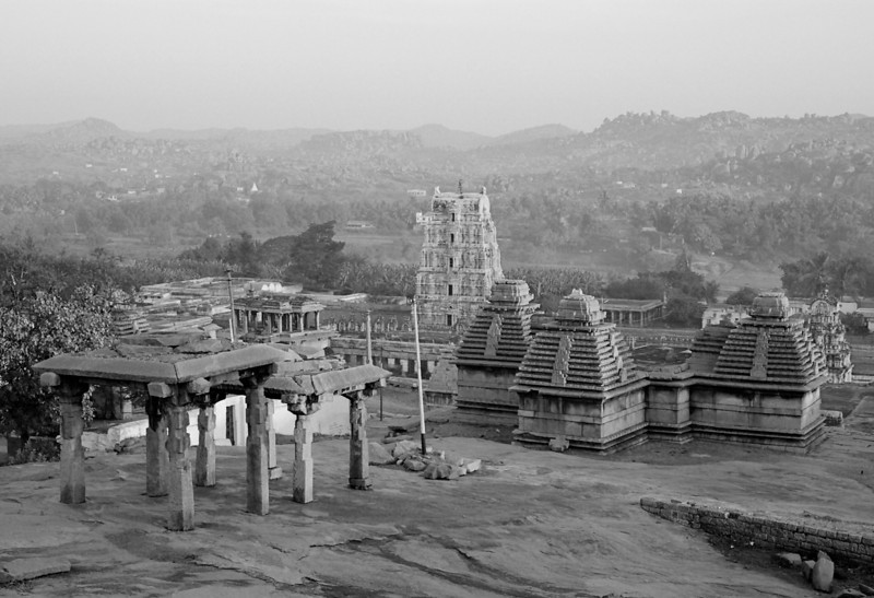 A view of the Virupaksha temple complex in the distance and the mandapams from the Hemakuta hills. The temples on the hill are a mix of Hindu and Jain shrines.