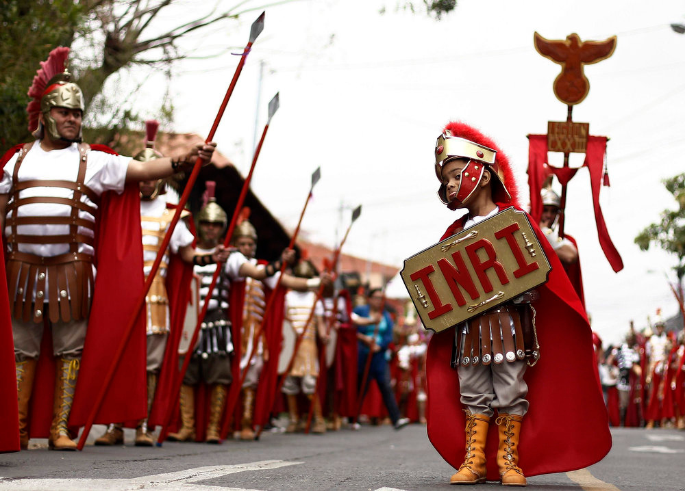 Description of . A boy dressed up as a Roman soldier takes part in a Good Friday procession in San Antonio de Escazu, near San Jose. March 29, 2013. Holy Week is celebrated in many Christian traditions during the week before Easter.  REUTERS/Juan Carlos Ulate