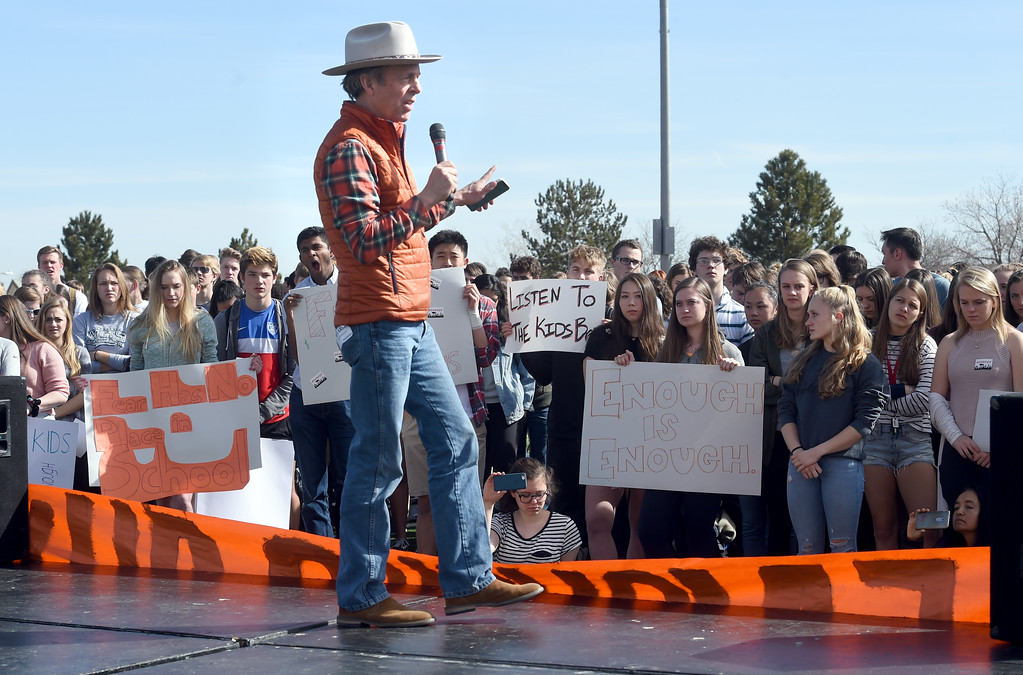 . Mark McKinnon speaks to the crowd at Fairview High School in Boulder. Students at schools across Boulder County and Broomfield walked out of class around 10 this morning as they took part in the nationwide protest of gun violence on the one-month anniversary of the massacre at a high school in Parkland, Fla., that left 17 dead. Cliff Grassmick  Photographer  March 14, 2018