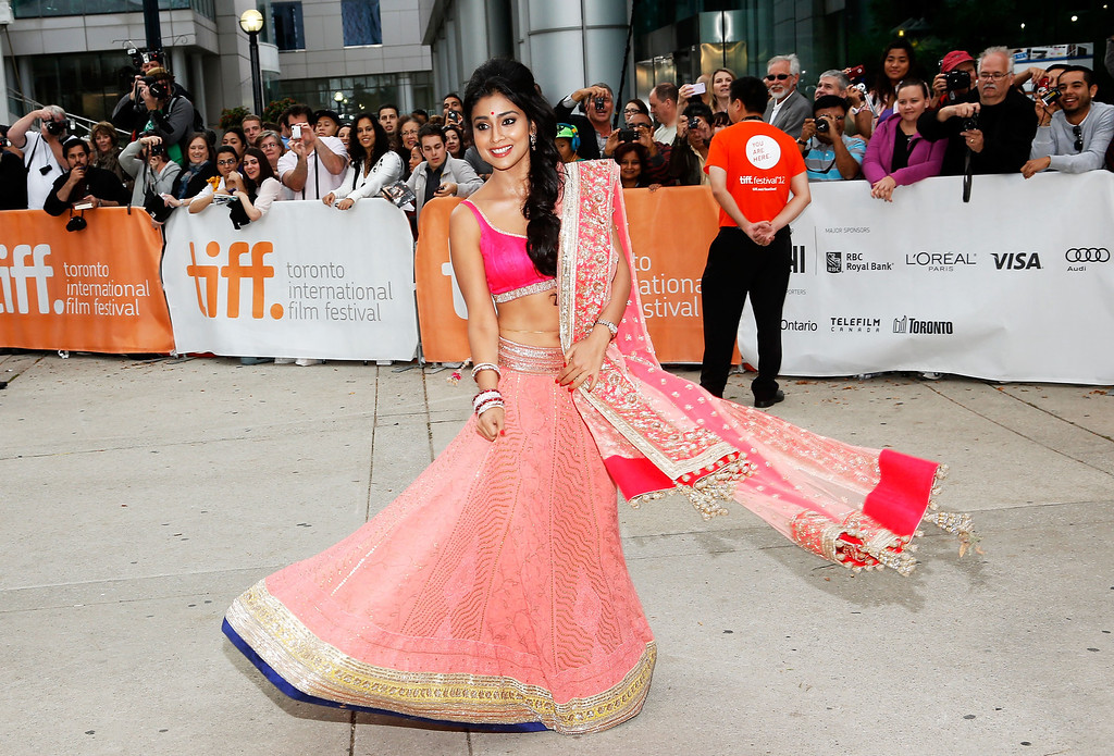 """. TORONTO, ON - SEPTEMBER 09:  Actress Shriya Saran arrives at the \""""Midnight\'s Children\"""" Premiere at the 2012 Toronto International Film Festival at Roy Thomson Hall on September 9, 2012 in Toronto, Canada.  (Photo by Jemal Countess/Getty Images)"""