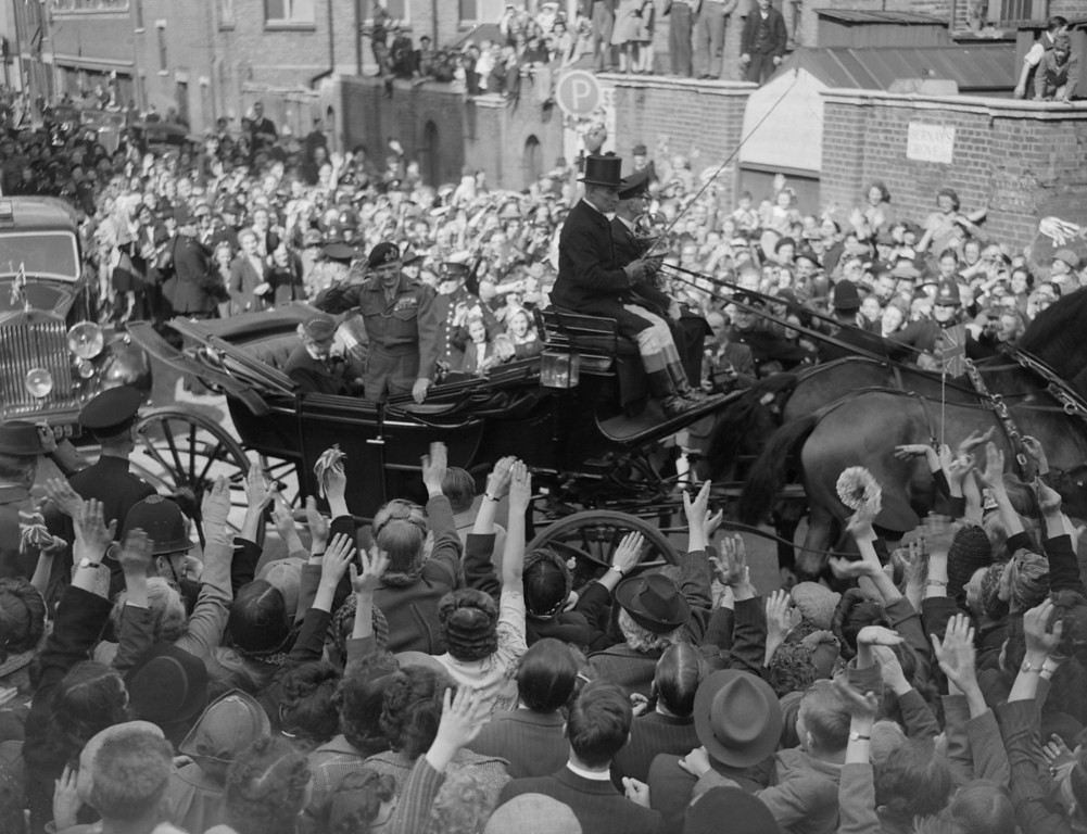. British military leader Field Marshal Bernard L. Montgomery, Viscount Montgomery of Alamein, waving as his carriage passes through crowds in the street celebrating VE Day, May 8, 1945.  (Photo by Express/Express/Getty Images)