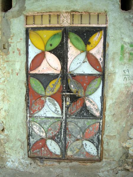 old painted metal door