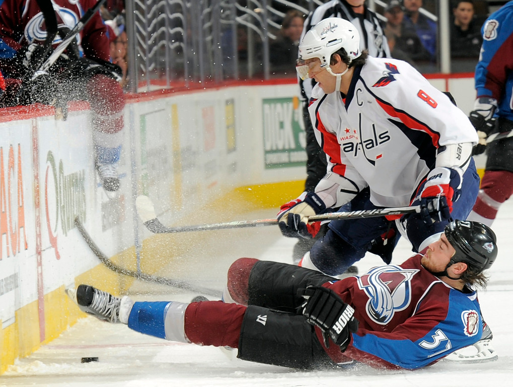. Colorado Avalanche center Ryan O\'Reilly (37) is knocked off his skates by Washington Capitals left wing Alex Ovechkin (8) during the first period of an NHL hockey game Saturday, Dec. 17, 2011, in Denver. (AP Photo/Jack Dempsey)