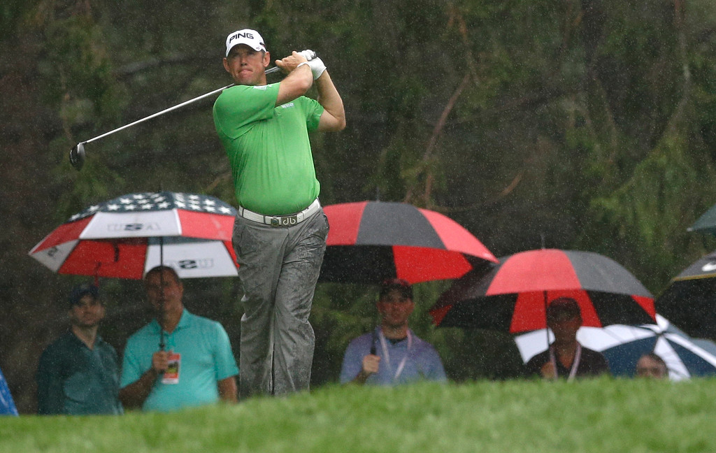 . Lee Westwood, of England, watches his tee shot on the 18th hole during the second round of the PGA Championship golf tournament at Oak Hill Country Club, Friday, Aug. 9, 2013, in Pittsford, N.Y. (AP Photo/Patrick Semansky)