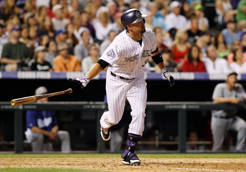 . Colorado Rockies\' Michael Cuddyer follows the flight of his solo home run against the Los Angeles Dodgers in the seventh inning of a 9-5 victory in a baseball game in Denver, Thursday, July 4, 2013. (AP Photo/David Zalubowski)