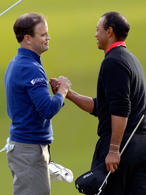 . Tiger Woods congratulates Zach Johnson after Johnson won the 1st playoff hole during the final round of the Northwestern Mutual World Challenge golf tournament at Sherwood Country Club, Sunday December 8, 2013, in Thousand Oaks, Calif.(Andy Holzman/Los Angeles Daily News)