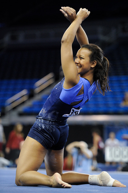 . UCLA\'s Lichelle Wong practices a floor exercise. (Michael Owen Baker/Staff Photographer)