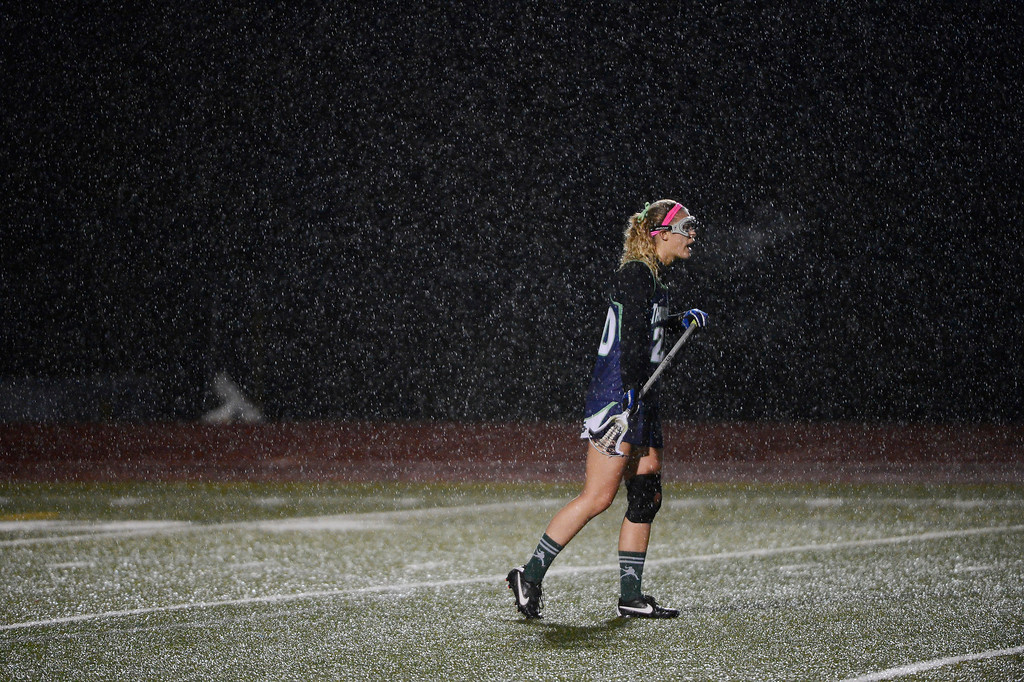 . LITTLETON, CO - MAY 8: Audrey Myers, ThunderRidge High School, braves the cold and rain during the game against Heritage/Littleton,  at Littleton Public Schools Stadium for the first round of the 2013 Colorado Girls State Lacrosse Championships May 8, 2013. ThunderRidge won 8-5. (Photo By Andy Cross/The Denver Post)