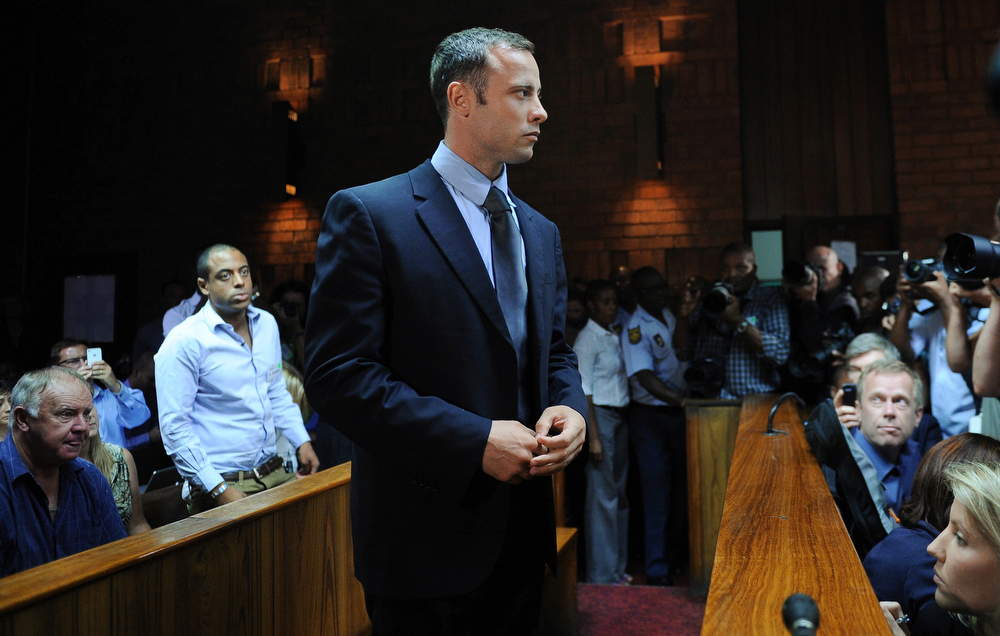 . South African Olympic sprinter Oscar Pistorius appears at the Magistrate Court in Pretoria on February 22, 2013. Pistorius battled to secure bail as he appeared on charges of murdering his model girlfriend Reeva Steenkamp on February 14, Valentine\'s Day. South African prosecutors will argue that Pistorius is guilty of premeditated murder in Steenkamp\'s death, a charge which could carry a life sentence. Pistorius denies the charge, saying that he shot 29-year-old Steenkamp repeatedly through a locked bathroom door in the dead of night by accident, having mistaken her for a burglar.  ALEXANDER JOE/AFP/Getty Images