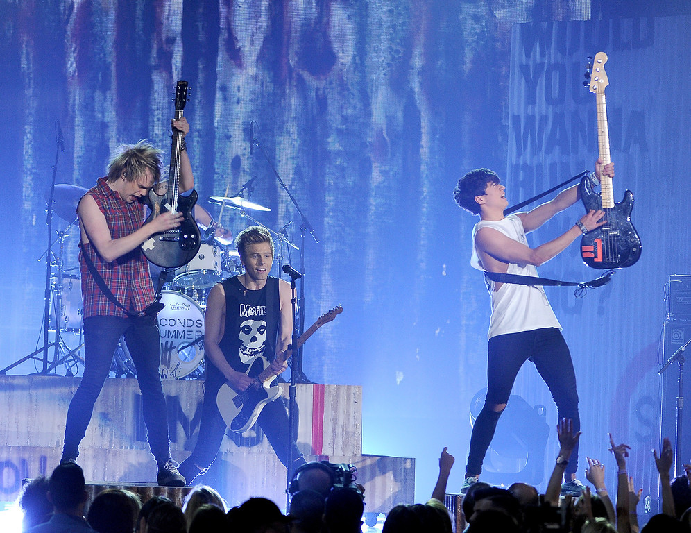 . Michael Clifford, from left, Luke Hemmings and Calum Hood, of the musical group 5 Seconds of Summer, perform on stage at the Billboard Music Awards at the MGM Grand Garden Arena on Sunday, May 18, 2014, in Las Vegas. (Photo by Chris Pizzello/Invision/AP)