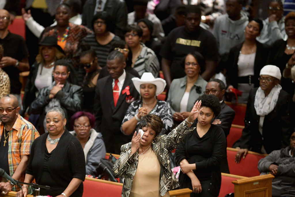 . BALTIMORE, MD - APRIL 27:  Mourners sing and pray during Freddie Gray\'s funeral at the New Shiloh Baptist Church during his funeral April 27, 2015 in Baltimore, Maryland. Gray, 25, was arrested for possessing a switch blade knife April 12 outside the Gilmor Homes housing project on Baltimore\'s west side. According to his attorney, Gray died a week later in the hospital from a severe spinal cord injury he received while in police custody.  (Photo by Chip Somodevilla/Getty Images)