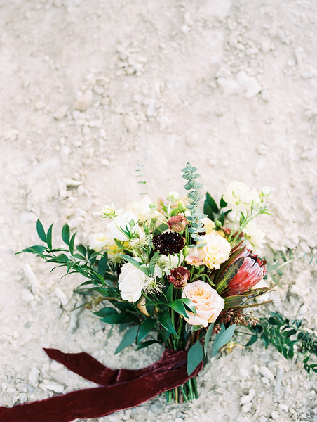 bridal bouquet with protea, scabiosa, eucalyptus and garden roses - Rooted Willow // desert elopement in Las Vegas - Mt. Charleston // Las Vegas Elopement  & Intimate Wedding Photographer - Kristen Krehbiel - Kristen Kay Photography