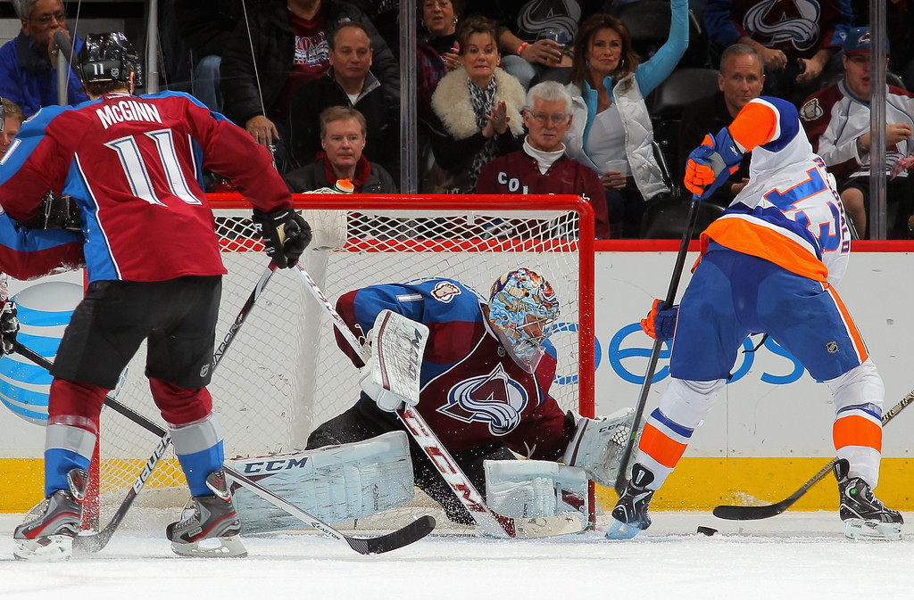 . DENVER, CO - JANUARY 10:  Goalie Semyon Varlamov #1 of the Colorado Avalanche defends the goal as Colin McDonald #13 of the New York Islanders tries to control the puck at Pepsi Center on January 10, 2014 in Denver, Colorado.  (Photo by Doug Pensinger/Getty Images)