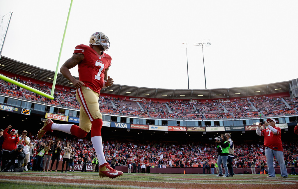 . SAN FRANCISCO, CA - AUGUST 08:  Colin Kaepernick #7 of the San Francisco 49ers runs onto the field for their preseason NFL game against the Denver Broncos at Candlestick Park on August 8, 2013 in San Francisco, California.  (Photo by Ezra Shaw/Getty Images)
