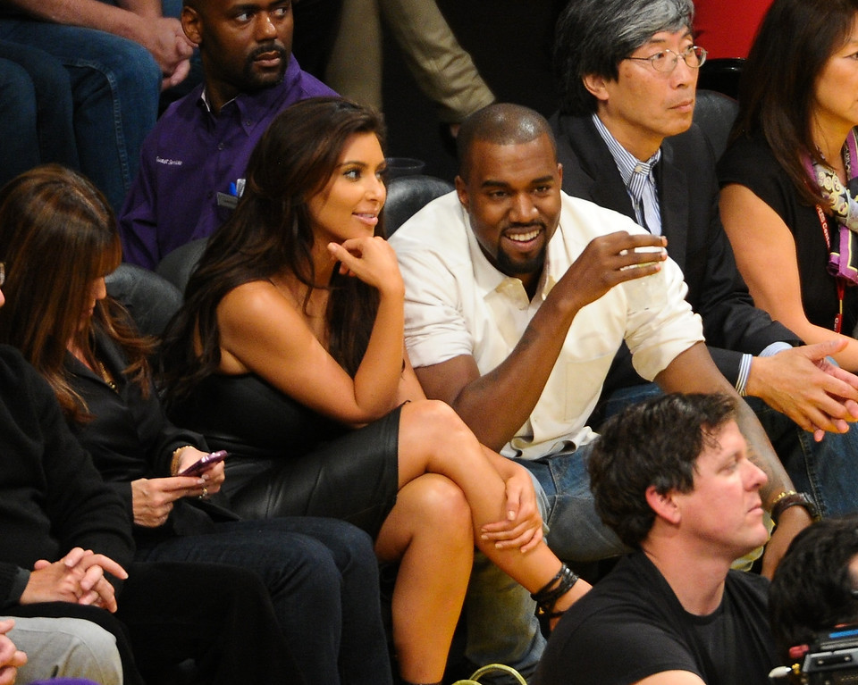 . LOS ANGELES, CA - MAY 12:  Kim Kardashian (L) and Kanye West attend the Los Angeles Lakers and Denver Nuggets Game 7 of the Western Conference Quarterfinals in the 2012 NBA Playoffs on May 12, 2012 at Staples Center in Los Angeles, California.  (Photo by Noel Vasquez/Getty Images)