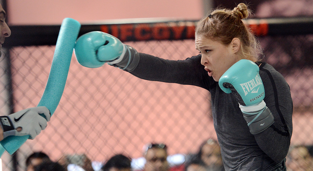 . UFC fighter Ronda Rousey works with coach Edmond Tarverdyan during an open workout at the UFC Gym in Torrance, CA Wednesday, February 20, 2013. (Hans Gutknecht/Staff Photographer)