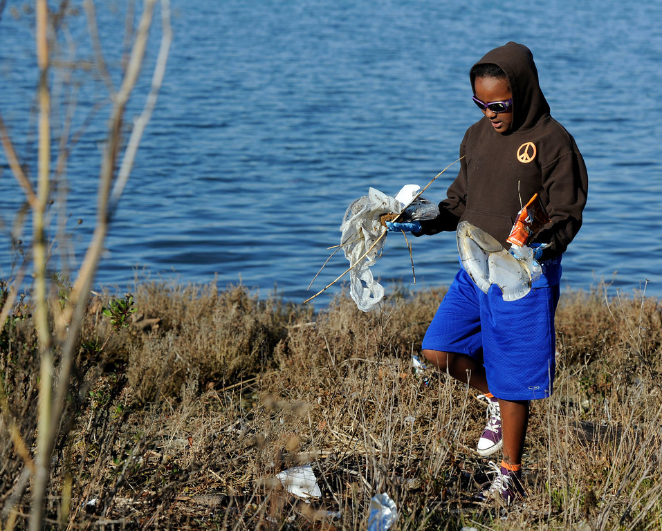 . Mestie Thomas, 10, of Berkeley, collects trash  to honor Martin Luther King Jr. for a day of service at Martin Luther King Jr. Shoreline Park  in Oakland, Calif., on Monday, Jan. 21, 2013. Mestie was one of several students from Washington School in Berkeley to participate in the event. (Susan Tripp Pollard/Staff)