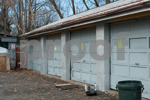 12/06/17 Wesley Bunnell   Staff A garage behind 116 West Street in the North Oak Section of New Britain with signs marking the building as condemned and unsafe after a fire in February 2017. Residents of the neighborhood have recently been speaking up regarding blight and alleged neglect from the city regarding their concerns.