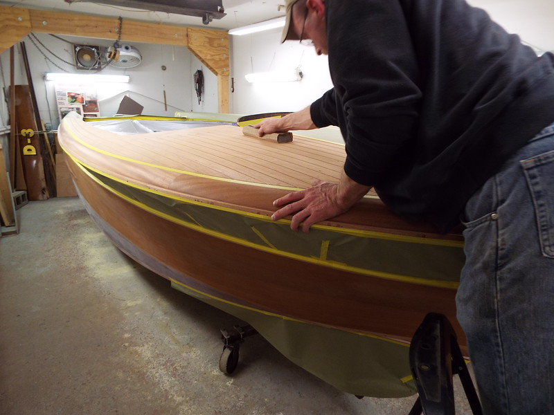 With the boat masked off we are now starting the final sanding before we stain the hull.