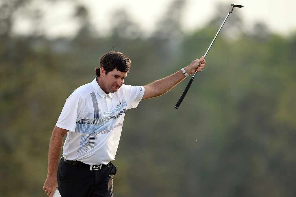 . Bubba Watson of the US reacts after putting on the 18th green during the 78th Masters Golf Tournament at Augusta National Golf Club on April 13, 2014 in Augusta, Georgia. Watson won his second Masters finishing 8-under par.   EMMANUEL DUNAND/AFP/Getty Images