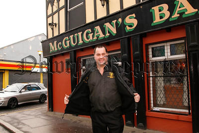 Gerard Mc Guigans of Mc Guigan's Bar Monaghan St is endeavouring to shed pounds in aid of Newry Hospice & Macmillan Nurses, In just three weeks he has lost one stone in pursuit of his target of two stone by St Patricks day, Gerard is being helped in his challenge by Deidre Murdock at Weightwatchers, 07W5N67