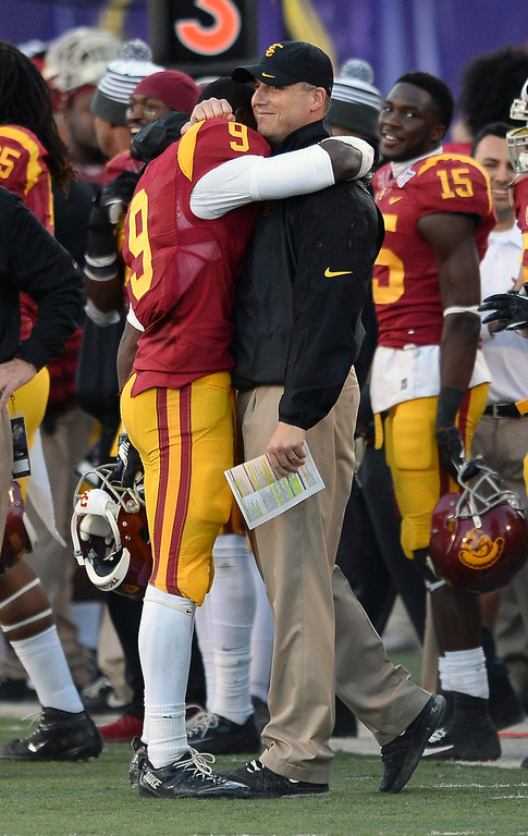 . LAS VEGAS, NV - DECEMBER 21:  Marqise Lee #9 of the USC Trojans hugs interim coach Clay Helton late in the team\'s 45-20 victory over the Fresno State Bulldogs to win the Royal Purple Las Vegas Bowl at Sam Boyd Stadium on December 21, 2013 in Las Vegas, Nevada.  (Photo by Ethan Miller/Getty Images)