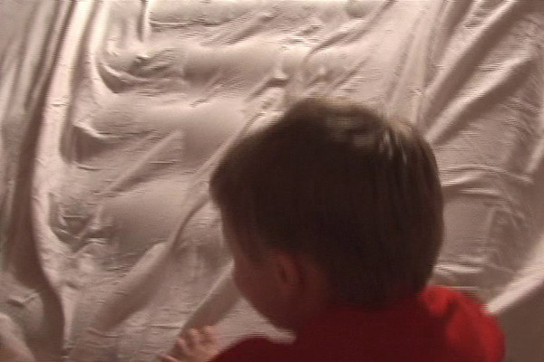 Having fun with my nephew Isaiah.  We turned our blow up matress into a mountain / slide.