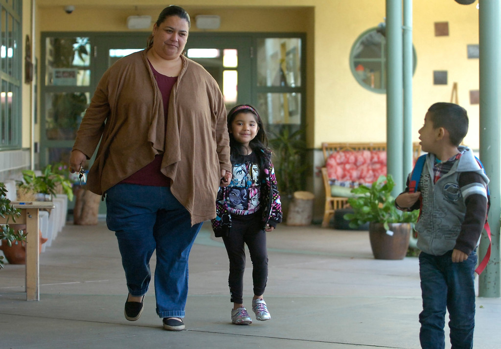 . Micaela Ramos walks to class with daughter Arelee Rodriguez, 5, as she drops her off at the George Miller III Children\'s Center in Richmond, Calif. on Wednesday, Feb. 27, 2013. Funding for the daycare center could be jeopardized by automatic spending cuts by the federal government. (Kristopher Skinner/Staff)