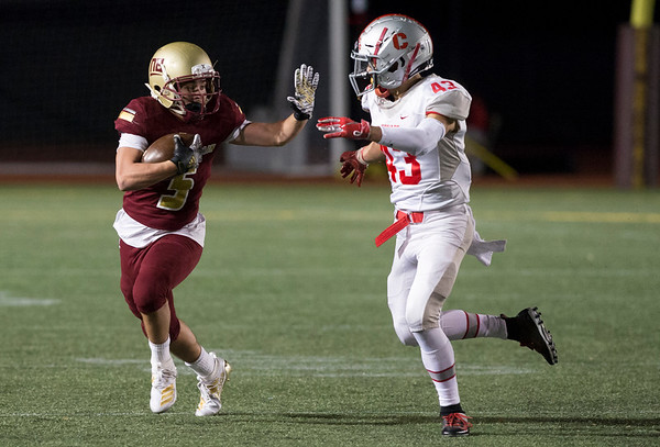 11/01/19 Wesley Bunnell | StaffrrNew Britain football was defeated 17-14 by Conard in OT in a game played on Friday night at Veterans Stadium. Travon Santoro (5) runs for yards after a catch.
